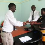 Prof Edward K Kirumira has hands over USD1310