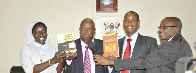 Mr. James Tumusiime (2nd L) flanked by the authors Sr. Dr. Dominica Dipio (L) and Dr. Aaron Mushengyezi (2nd R) and emcee Dr. Danson Kahyana (R) launch the two books on 31st October 2014, Makerere University, Kampala Uganda