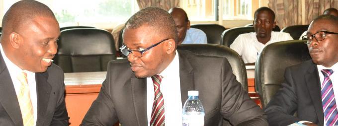 Kampala Lord Mayor, Ssalongo Erias Lukwago, and City Lawyer Fred Muwema share a light moment during the seminar