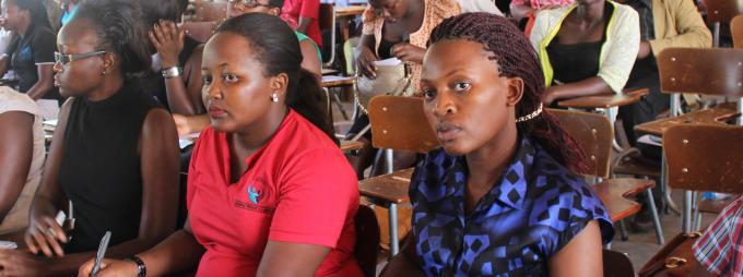 Students follow the proceedings during the public dialogue held at the School of Women and Gender Studies to celebrate the International Women's Day