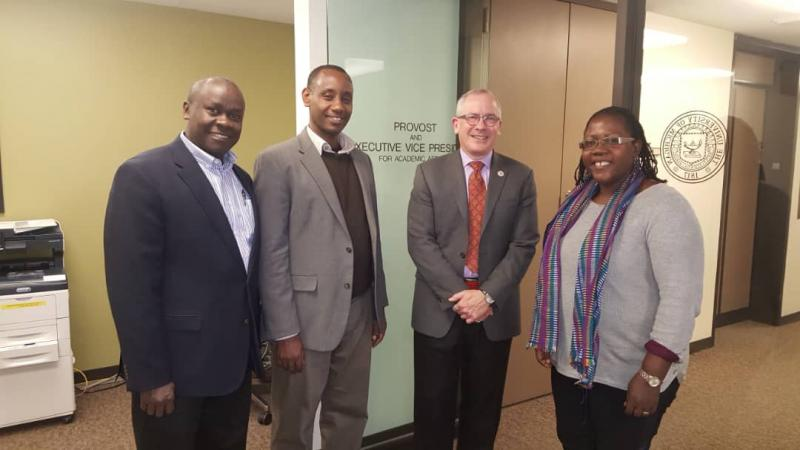 Dr Josephine Ahikire, Dr Aaron Mushengyezi (2nd Left), Dr Andrew State (Left) with Prof. James P. Holloway, Vice Provost for Global Engagement and Interdisciplinary Academic Affairs, University of Michigan