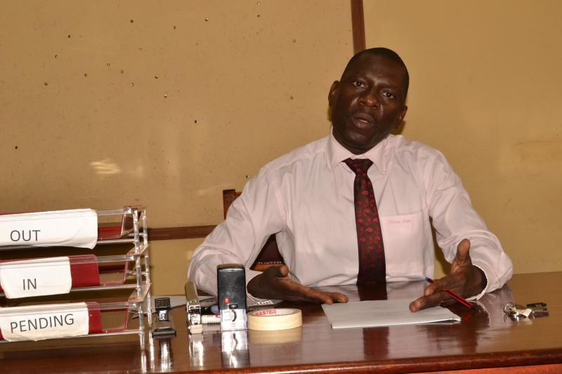 Dr Kikooma presents the handover report