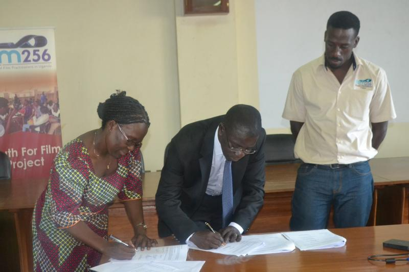 Prof. Kirumira, & Assoc. Prof. Tamusuza sign the MoU