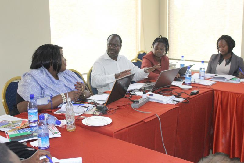 Dr Julius Kiiza (2nd L) researched on the politics of life presidency legislation in Uganda