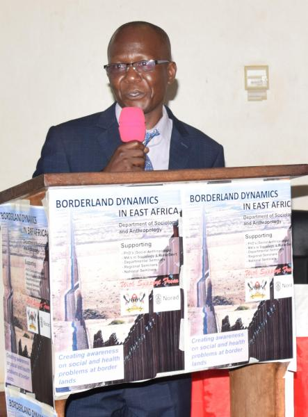 Dr Eria Olowo Onyango, the Coordinator Bordeland Dynamics in East Africa Project at Makerere University addresses participants