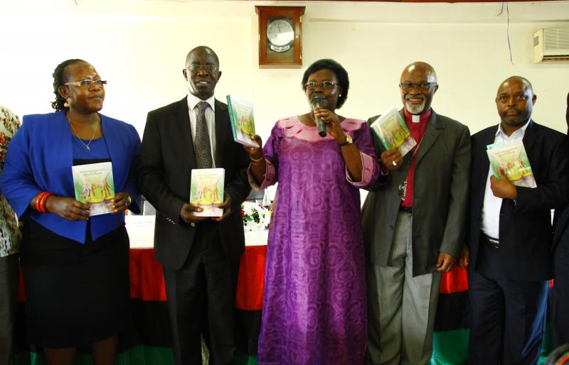 Hon. Grace Kwiyucwiny (C) launched the book