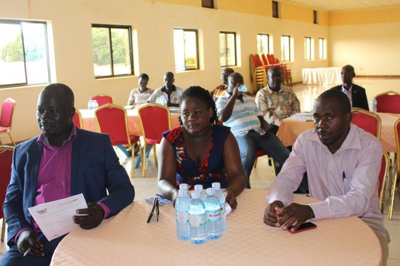 Participants follow the proceedings