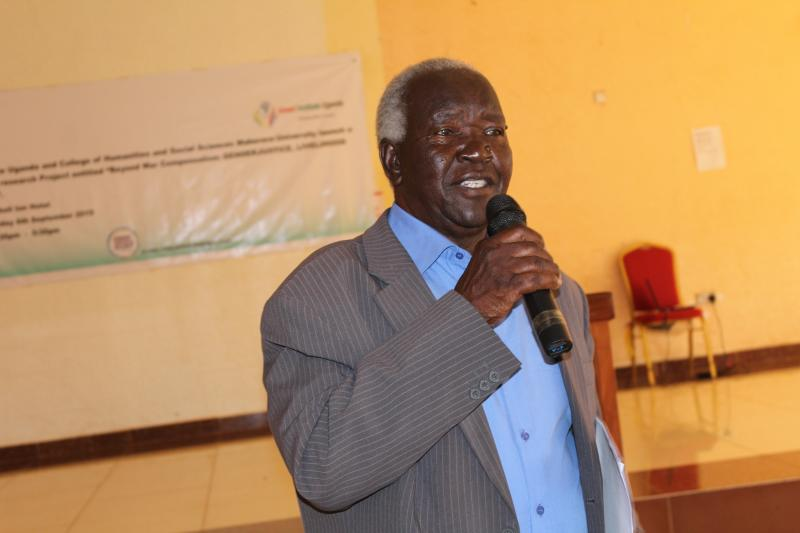 Rwot Yusuf Adek shares his views during the project impact workshop in Gulu