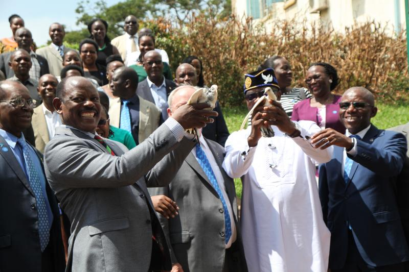 Prof. Nawangwe and VP Babalola prepare to release doves symbolizing the launch of the peace centre