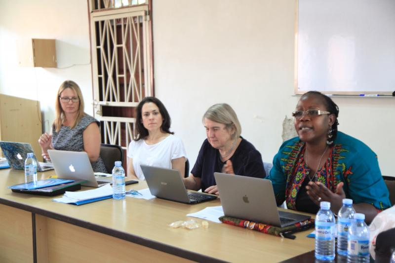 Dr Ahikire (R) and Prof. Chinkin (2nd R) in a meeting at the School of Women and Gender Studies
