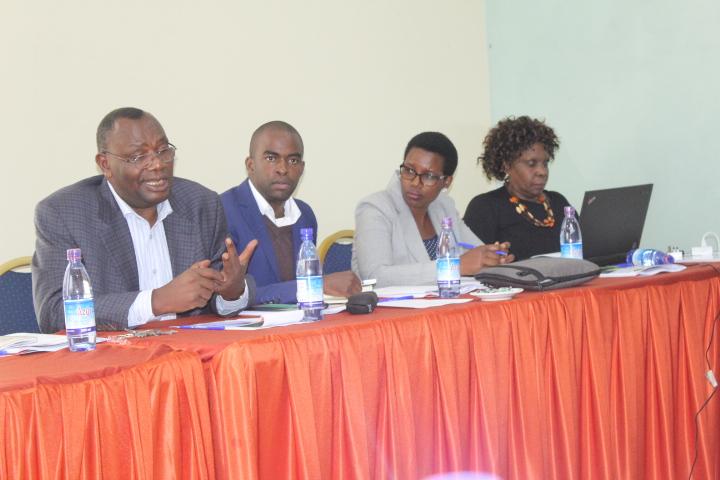 Dr Sabiti Makara (L) delivers his presentation