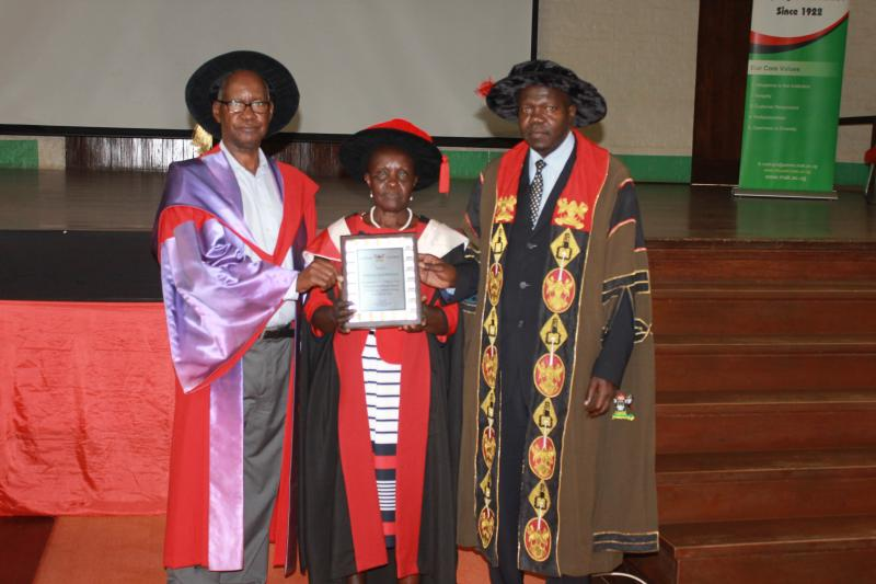 Prof. Mukama received a plaque and certificate in recognition of her outstanding services to the University