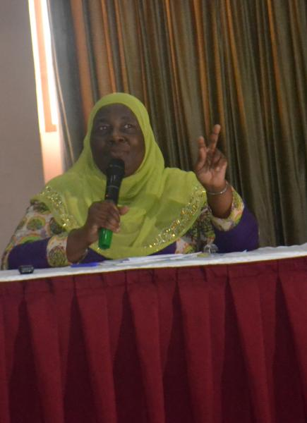 The Guest of Honour, Hon. Janat Mukwaya, addresses participants