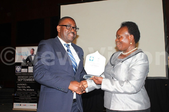 Executive Director of Uganda Wildlife Authority Andrew Seguya receiving the Most Benevolent CEO of the year award