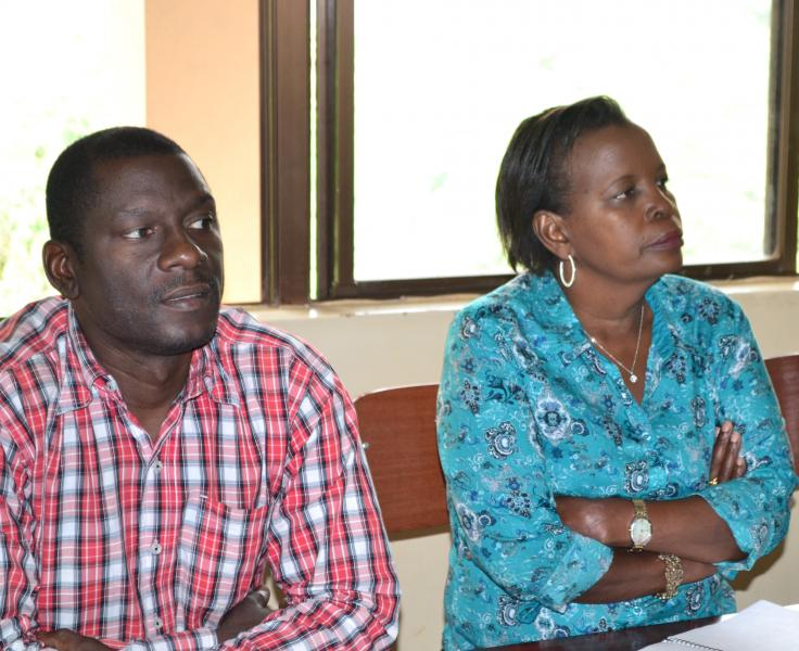 The Dean, School of Psychology, Dr Julius Kikooma, and the Director, Human Resources, Mrs Mary Tizikara, at the workshop